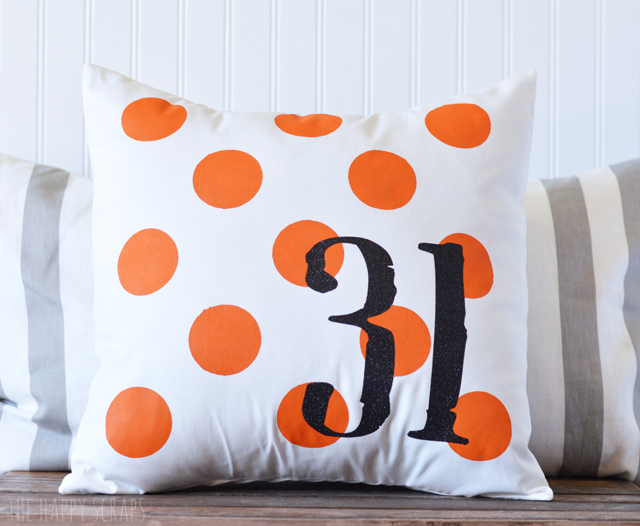 This Halloween Polka Dot Pillow is easier to make than you'd think + it will bring a fun pop of color to your Halloween decor!