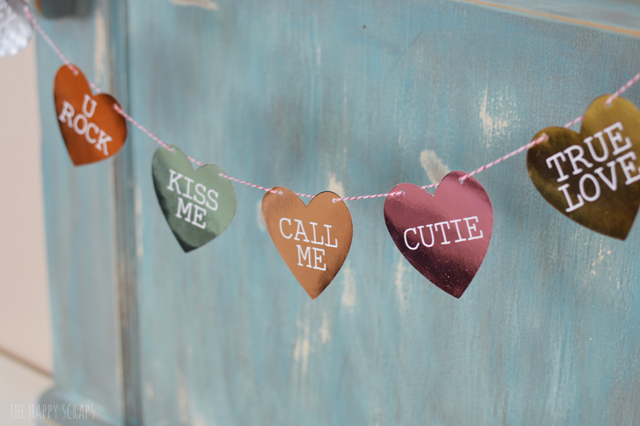 This Foiled Conversation Heart Banner is the perfect addition to any Valentine's Day decor. It doesn't take long to create either.