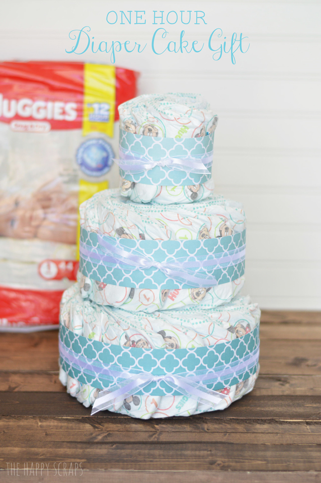 Need a baby gift? This Huggies diaper cake takes less than an hour to make and is the perfect First Time Mom Gift. Make one for a give today!