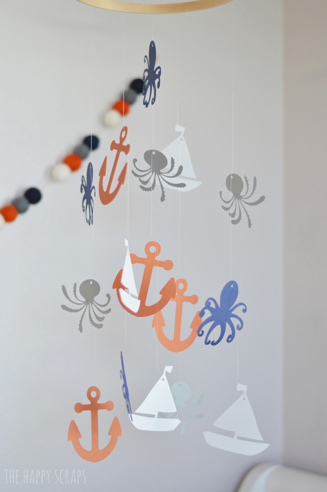 Create a DIY Baby Mobile with just a few supplies, and make it personalized for your nursery space.