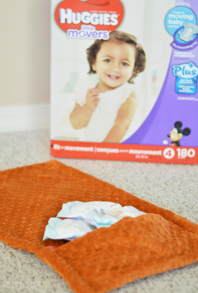 Create a Fold Up Changing Pad to make sure you are always prepared to change your baby's diaper + keep it stocked with Huggies Little Movers Plus diapers.