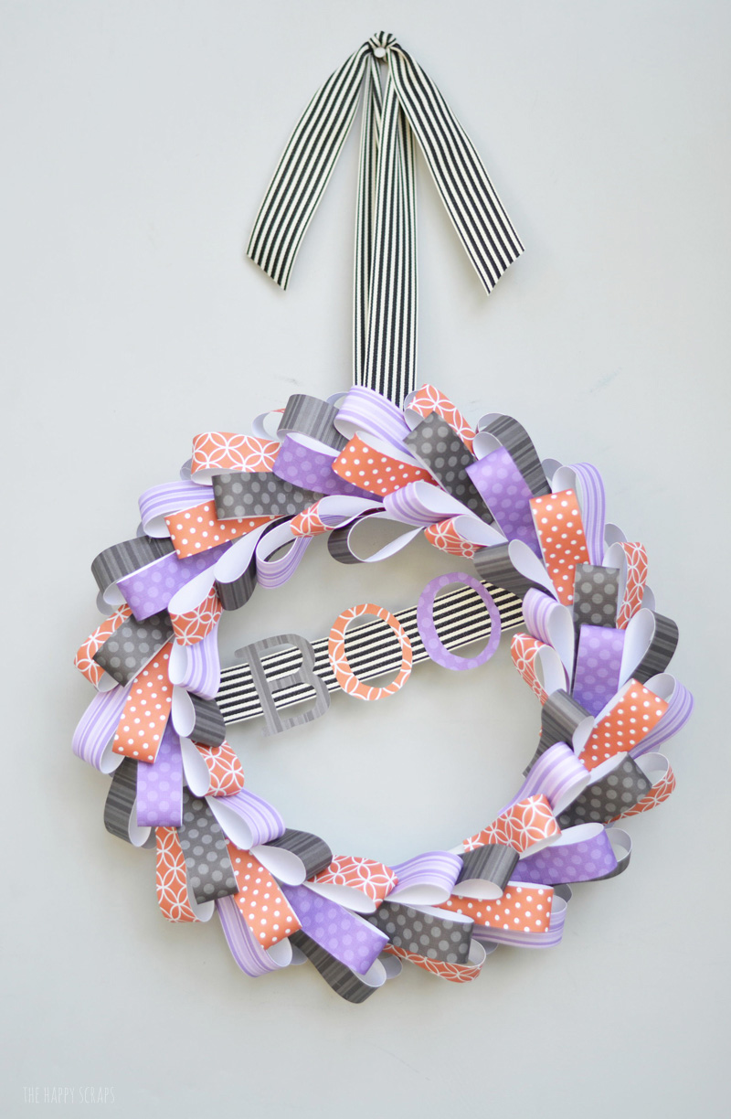 Make this fun BOO Halloween Wreath to hang on your front door. It's made from paper, and so simple to make!