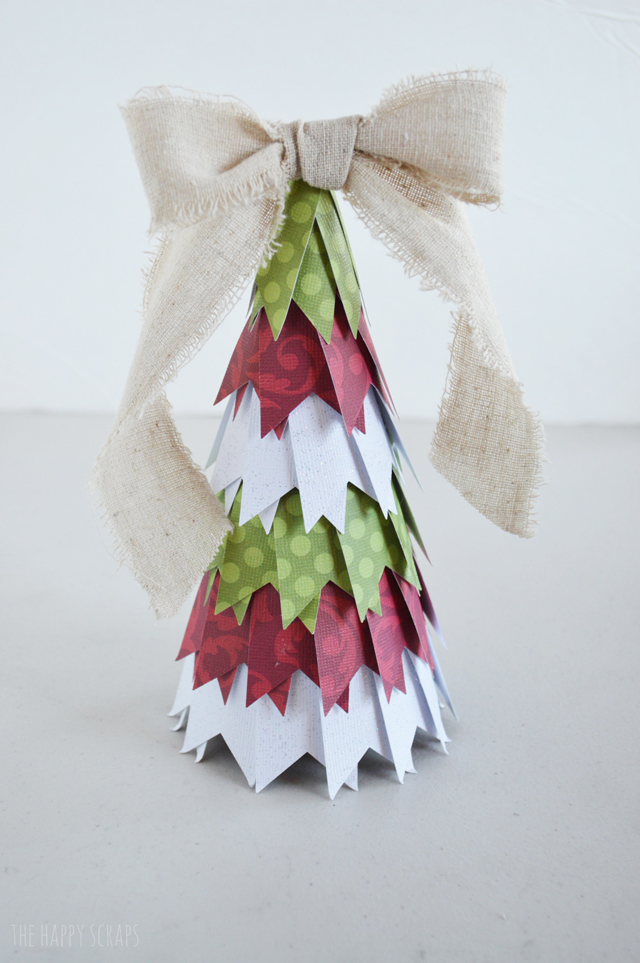 These Paper Christmas Trees are so easy to make and are the perfect addition to any other Christmas decor. Stop by the blog to learn how to make them.