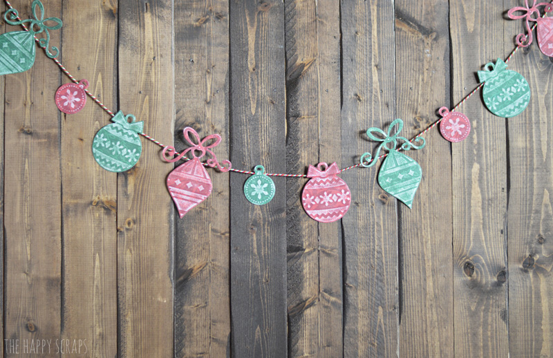 Create this simple Paper Christmas Garland with cardstock, baker's twine and your Cuttlebug. It's easy to do, I show you how on the blog.