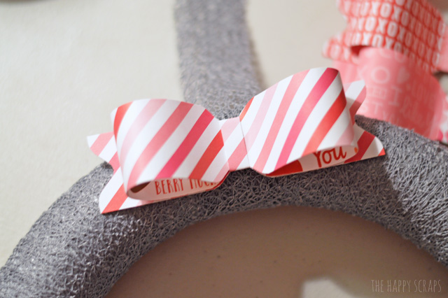 Decorate your front door for Valentine's day with this fun Valentine Paper Bow Wreath. It's easy to make. I'm sharing the tutorial on the blog.