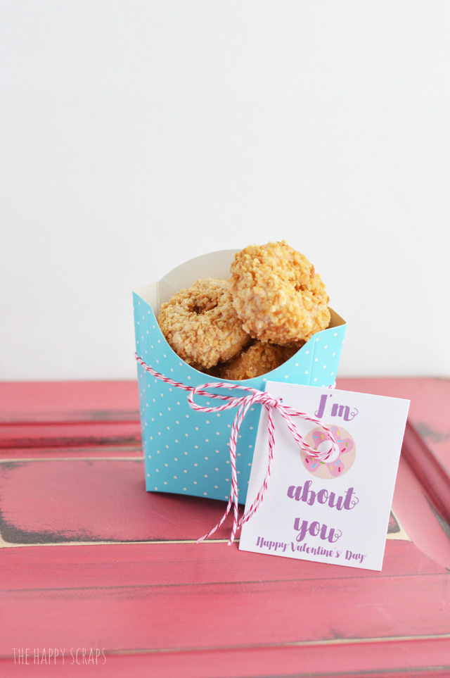 "Play on words gifts are so fun! Grab some donuts and this ""I'm Donuts About You, Valentine"" printable and put together some cute + simple valentine gifts!"