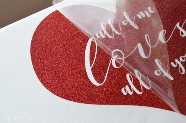 Glitter Iron-on vinyl is so fun to work with! It's mess free and you still get the shimmer. Learn how I used it to make this Valentine's Day Pillow.