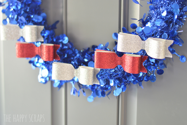 Everyone needs some Red, White & Blue to decorate for the 4th of July, and this sparkly Patriotic Wreath is perfect! Stop by the blog to get the tutorial!