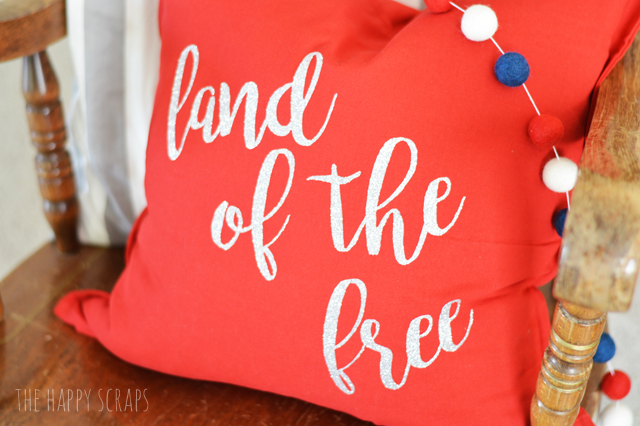 Decorate with throw pillows for the 4th of July. They are easy and fun to make! Get the details for this Land of the Free 4th of July Pillow on the blog.