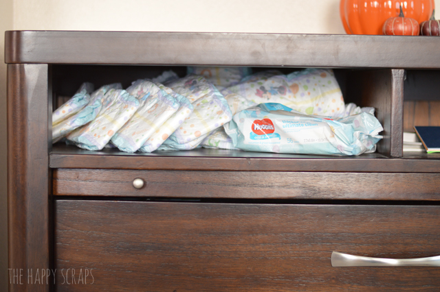 With a little one, it's nice to have diapers in more than one room. We keep some diapers in the family room, so I created this Family Room Diaper Organizer.