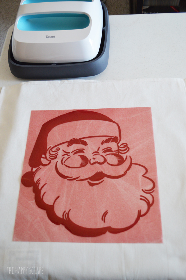 Everyone needs this Vintage Santa Claus Christmas Pillow in their home. It's pretty simple to make + it's so fun! Get the details on the blog.