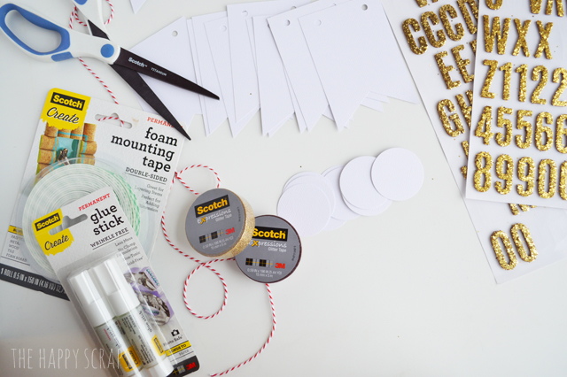 Scotch® Brand products make banner making easy! Stop by the blog and learn how to make this DIY Glittery Peace on Earth Banner.
