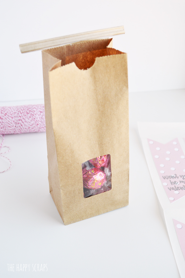"Putting together this Valentine Treat Bag is simple with this fun ""Won't you be my Valentine?"" tag. Get the print on the blog, and use your Cricut to cut it out!"