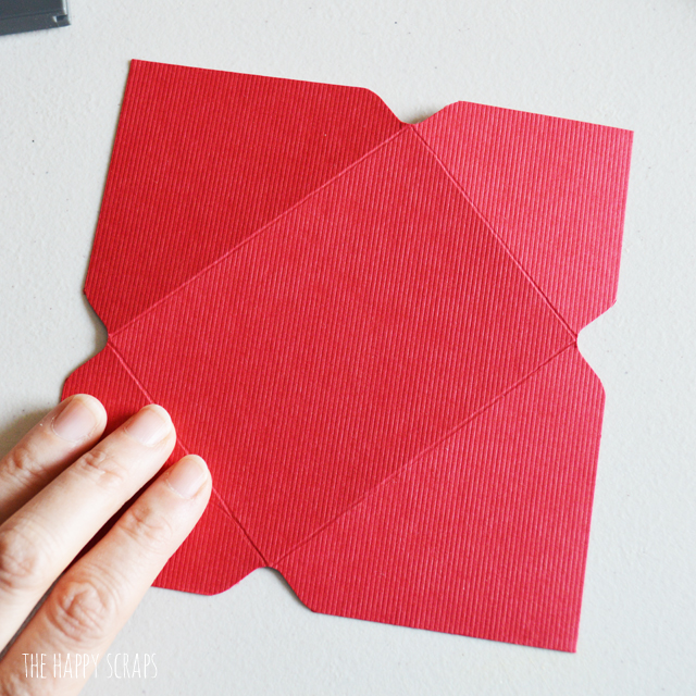 "This Mini Envelope Valentine Banner is the perfect addition to your Valentine decor. The mini envelopes are so cute and the puffy heart stickers make the perfect ""stamps."" Create your own with the tutorial on the blog."
