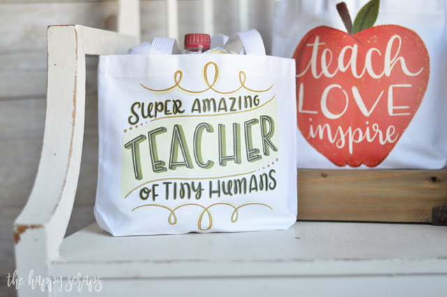 This Teacher Appreciation Gift Bag with Cricut Iron-on Designs is the perfect gift for all those school teachers! Fill it up with some fun supplies and their favorite treats. They will love what's inside, but they'll love the cute bag even more!!