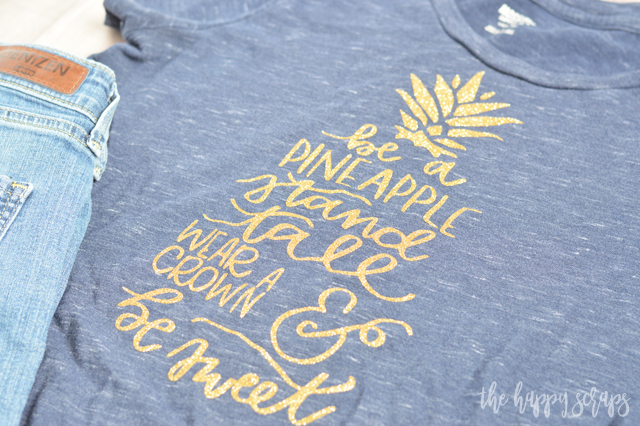 Everyone needs one of these Be A Pineapple Glitter Tee shirts. The glitter makes it so fun and sparkly + there is no mess when using glitter iron-on! Get the details for this from The Happy Scraps.