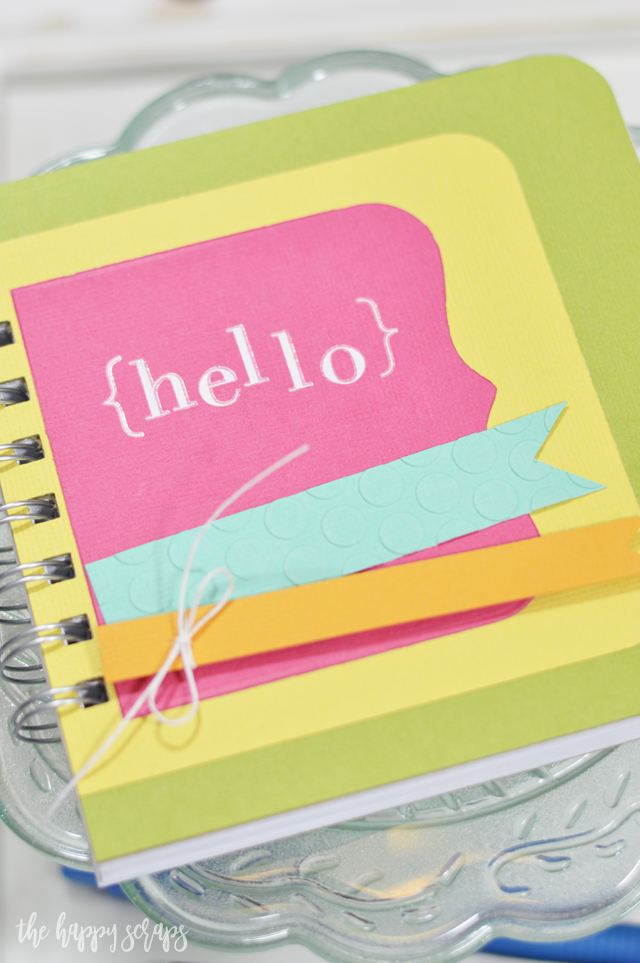 This Hello Mini Notebook is the perfect project for an afternoon craft session. No patterned paper needed, just some good quality cardstock.