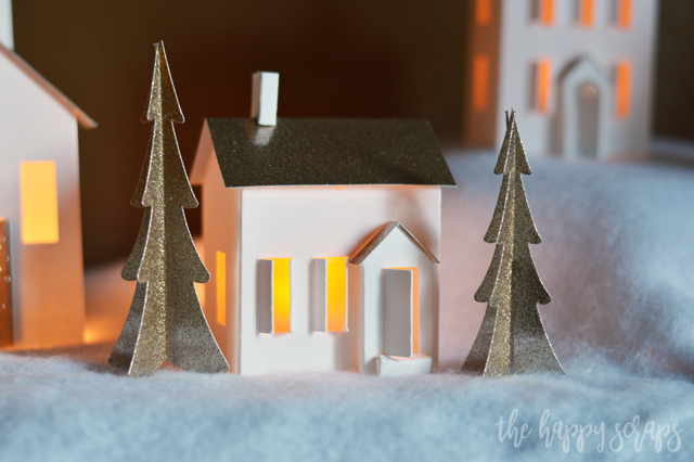 Creating this beautiful DIY Christmas Village with the Cricut Maker is fun and easy! This is the perfect project to get you in the holiday spirit!