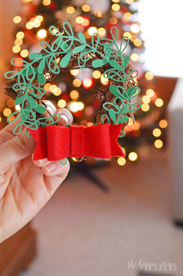 Creating these DIY Mini Christmas Wreaths for Kitchen Cabinets is a fun + simple project to add a pop of holiday to your kitchen. Tutorial on the blog.