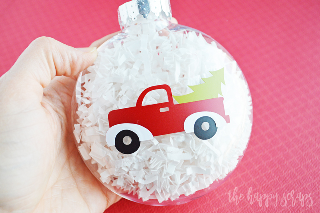 You'll have this DIY Red Truck Christmas Ornament put together in no time! Also learn how to layer multiple colors of vinyl!