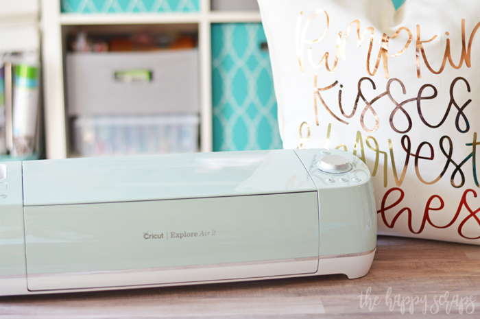 Considering purchasing a Cricut machine? Find out What I Love About the Cricut Explore Air 2 + make this Fall Harvest Pillow along with me.