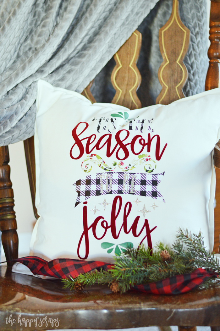 Add this fun 'Tis the Season Christmas Throw Pillow to your Christmas decor this year. Using Expressions Vinyl + your Cricut makes it easy.