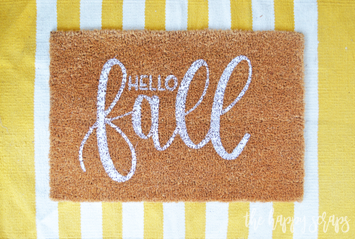 Having a DIY Hello Fall Front Porch Rug is the perfect way to welcome the fall weather! Get the details for creating your own on the blog.