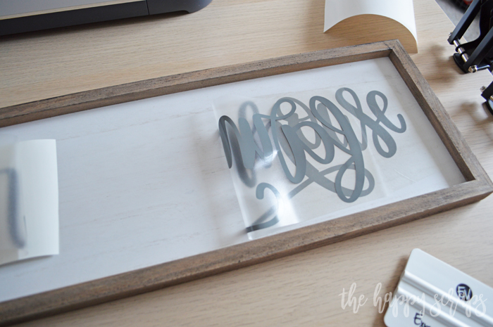 Learn how to use vinyl to create this Bless Our Farmhouse Kitchen Sign. It is a fun project that is perfect for any home.